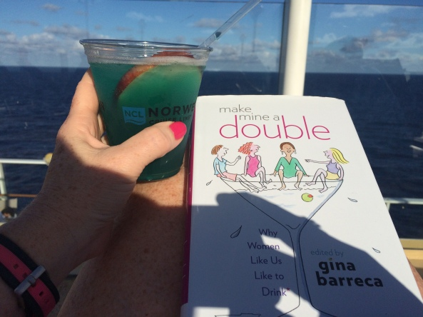"A cocktail and a good book. So perfect together. ""Make Mine A Double,"" by Gina Barreca. Perfect read on a cruise!"
